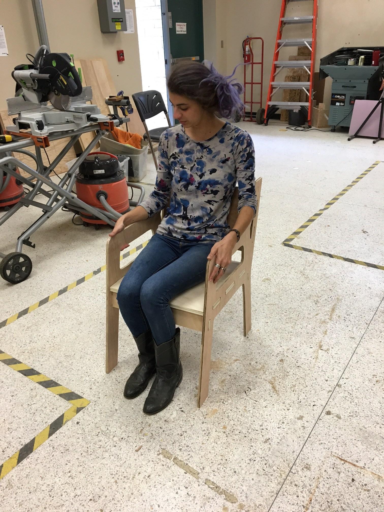 Emelle Tunceren testing her chair