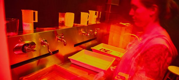 Photo of woman in photography darkroom.