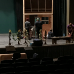 Photo of students working on the set