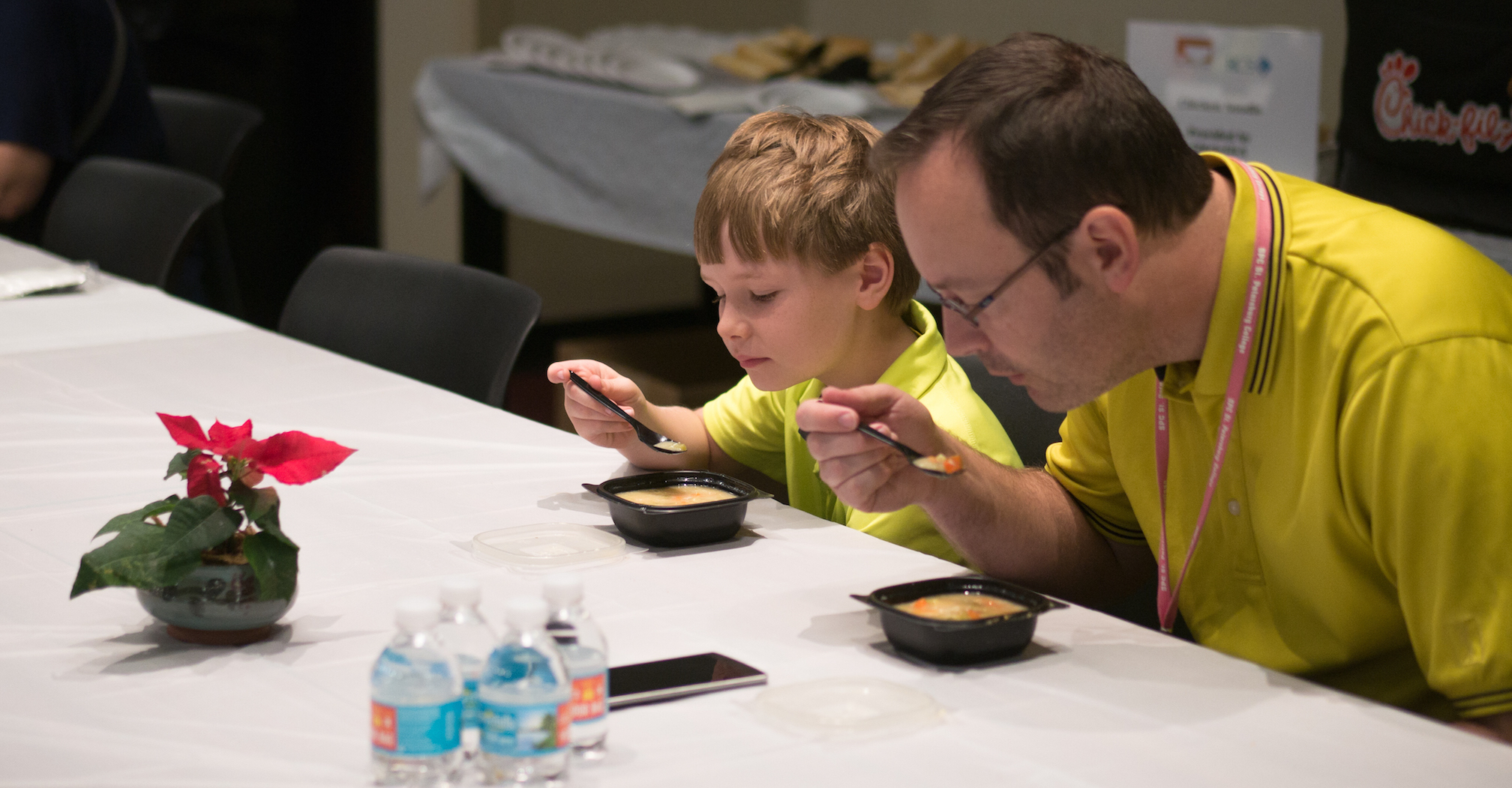 Father and son eating lunch at Empty Bowls