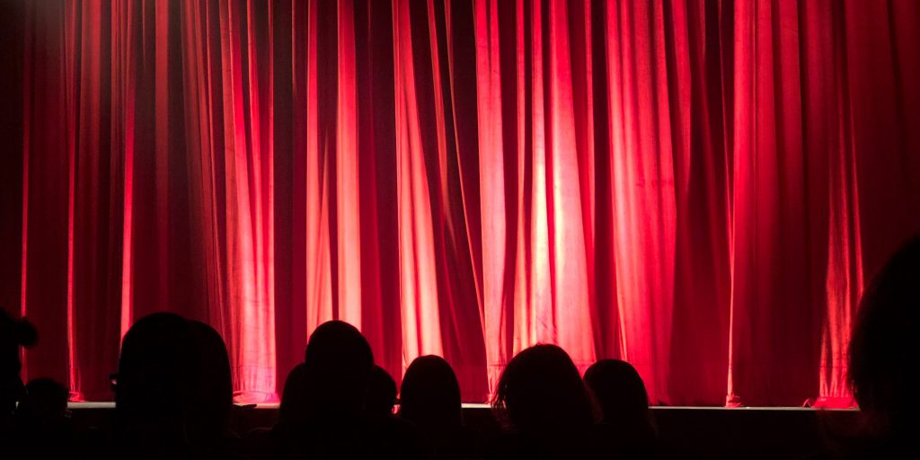 A red curtain over a theater stage