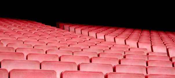 Rows of empty red theater seats