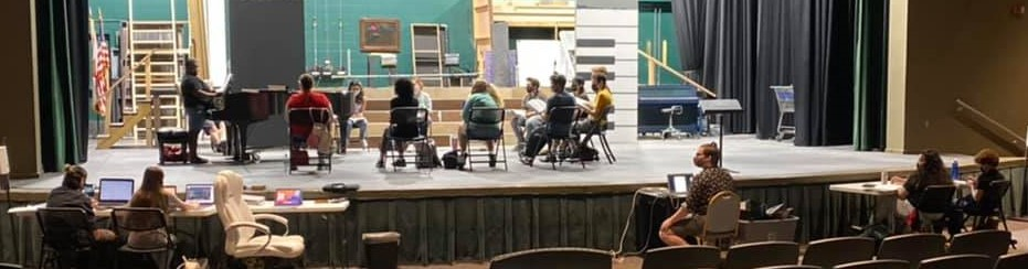 Tech crew and actors work on production