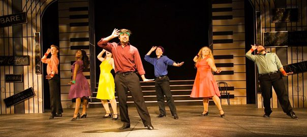 Actors form a chorus line behind the lead