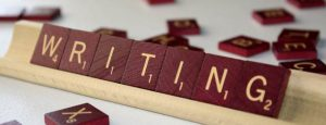 Scrabble tiles spelling out 'writing'