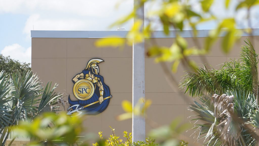 An exterior shot of an SPC building with Titus the Titan on the side of it