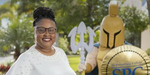 Belinthia Berry stands with Titus the Titan mascot.