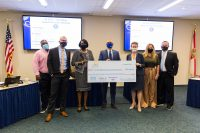 SPC board members, President Dr. Tonjua Williams and Vice President Jesse Turtle celebrate an award of more than $57,000 in scholarships from The Florida College System Foundation.