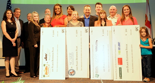 BPEPC 2013 Winners standing on stage holding checks