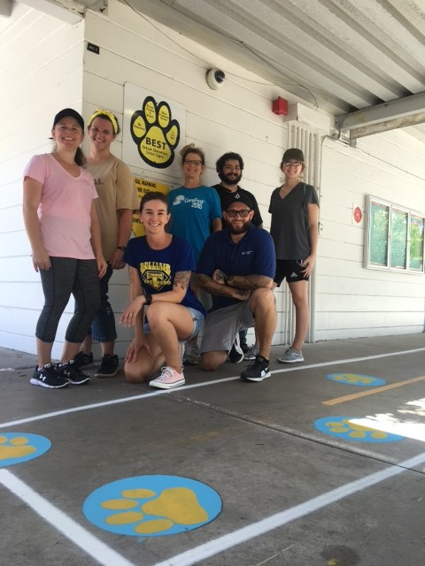 SPC volunteers repaint 100 paw prints at local elementary school.