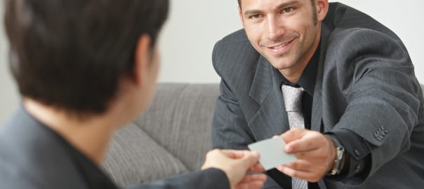 Two people exchanging business cards; soft skills