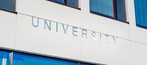 A building is shown with a sign across it that says University.