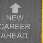 """Road with """"new career ahead"""" written and arrow facing forward"""
