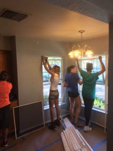SPC Students help fix windows