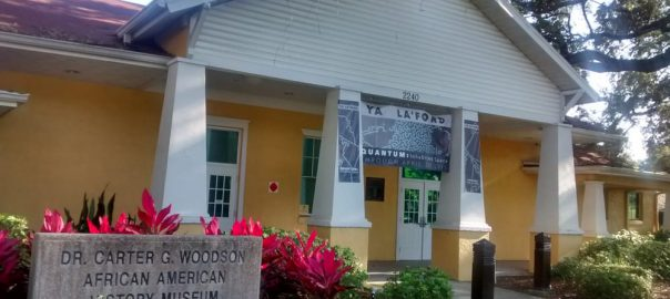 Dr. Carter G. Woodson Museum located in St. Petersburg. Yellow building with white pillars on either side of the entrance.