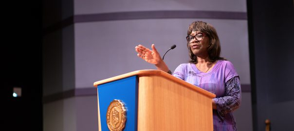 Poet Patricia Smith reading poetry at podium
