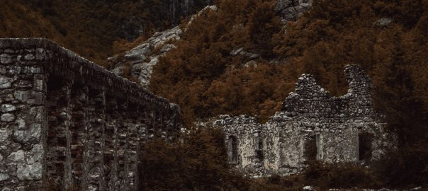 Moody crumbling ruins in a forest changing orange with the seasons.