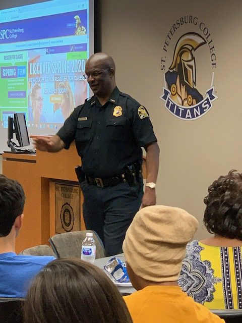 St. Petersburg Police Chief Anthony Holloway speaks to members of the audience at a presentation on communication skills.
