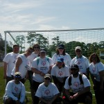 SPC volunteers at the Special Olympics in front of the soccer goal.