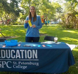 COE student helping with Early Childhood Storybook Village and 5K event