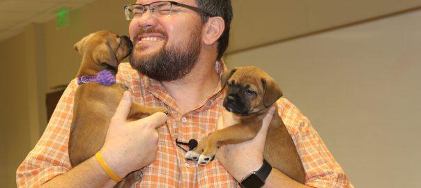 Charley Belcher with Vet Tech Puppies