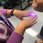 Blacklight over finger nails