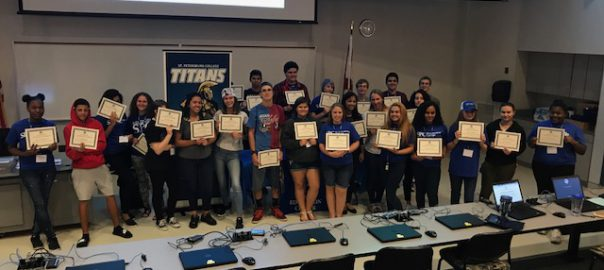 health career students holding up their certificates