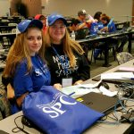 Students wearing SPC hats