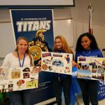 Students holding up their vision boards