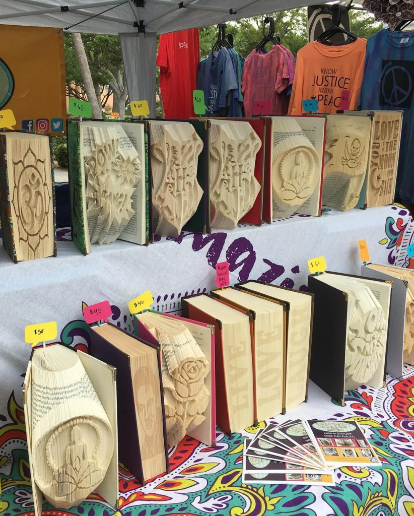 A display of books folded through Lauren's business, Dilly Dally's Custom Book Folding.