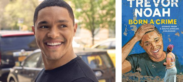 "A photo of comedian and author Trevor Noah beside his book, ""Trevor Noah: Born a Crime, Stories from a South African Childhood."""