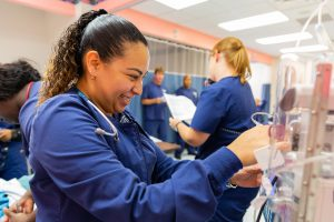 Nursing student works with equipment during a training session
