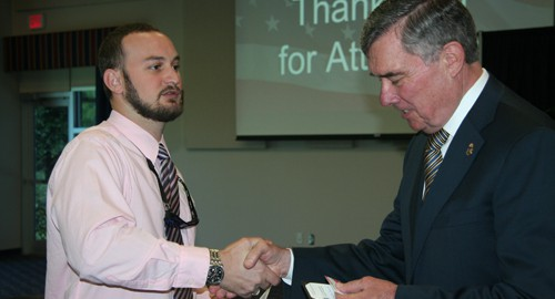 SPC Public Policy student Nicolas Louis interacting with Commissioner Kerlikowske.