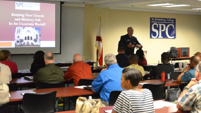 """Dr. Fronrath, St. Petersburg College Allstate Center Provost, speaking to the audience at the SPC Center for Public Safety Innovation (CPSI) """"Keeping Your Church and Ministry Safe in an Uncertain World"""" training event held Friday, September 25th, 2015 at the Allstate Center"""