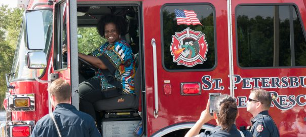 Student sits in the drivers seat at the annual Touch a Truck Celebration