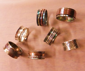 """Examples of kinetic """"spinner"""" rings created by SPC students."""