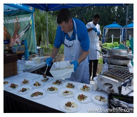 Chefs from the Guy Harvey Outpost, a TradeWinds Beach Resort, prepare and and serve up a tasty helping of lionfish.