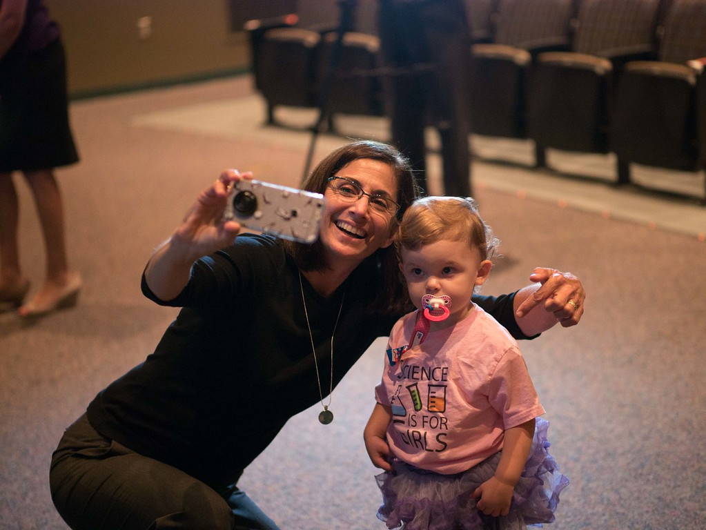"Artist and former astronaut Nicole Stott takes a selfie with Jordan ""Buggy"" Ulrich at the Women2STEM Symposium."