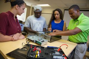 SPC cybersecurity faculty and students learning hands-on