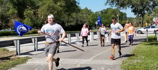 veterans wave flags during fun run